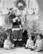 A personal visit from Santa Claus - stock photo