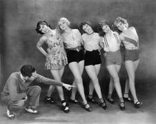 Director working with female dancers - stock photo