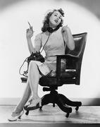 Portrait of nurse talking on telephone Stock Photos