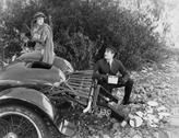 Woman and chauffer after car accident in country Stock Photos