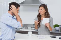Angry couple doing their accounts - stock photo