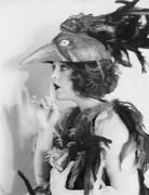 Portrait of woman wearing bird costume Stock Photos