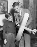 Brothers with model airplane Stock Photos