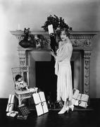 Woman stuffing Christmas stocking - stock photo