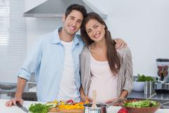 Portrait of a man and his pregnant partner - stock photo