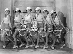 Row of female tennis players in matching outfits - stock photo