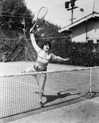 Female tennis player reaching for shot Stock Photos