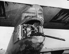 Gunner firing from plane - stock photo