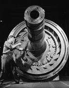 Male worker with massive machinery - stock photo