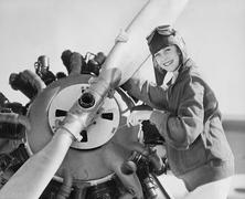 Portrait of woman with plane propeller Stock Photos