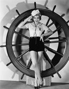 Portrait of woman in sailor costume - stock photo