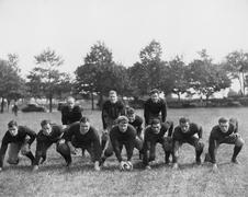 Football team in field - stock photo