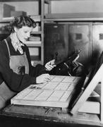 Woman working in printing shop Stock Photos