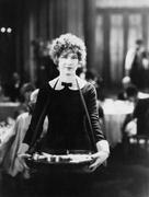 Portrait of cigarette saleswoman - stock photo