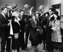 Group of people taking hats off to woman - stock photo