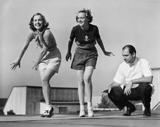 Man coaching two female dancers Stock Photos