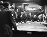 Stock Photo of Mobsters meeting around pool table