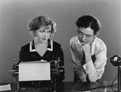 Two women with typewriter Stock Photos