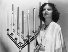 Portrait of woman with candelabra Stock Photos