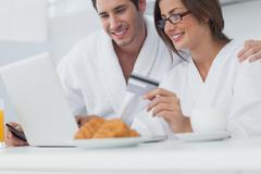 Couple purchasing online - stock photo