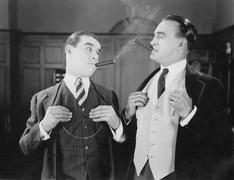 Two men smoking cigars - stock photo