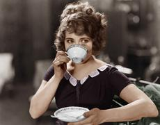 Portrait of woman drinking from teacup Stock Photos