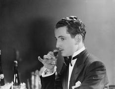 Man drinking glass of liqueur - stock photo