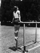 Gymnast on parallel bars outside Stock Photos