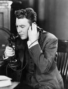 Man talking on telephone - stock photo