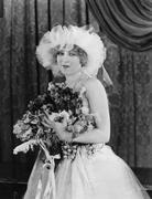 Portrait of bride with bouquet - stock photo
