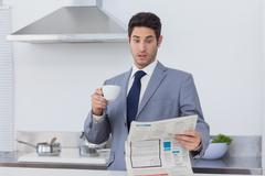Businessman being astonished when reading the news Stock Photos