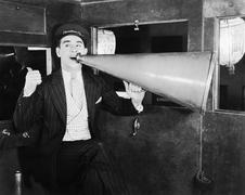 Man with huge megaphone Stock Photos
