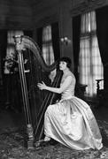 Nainen pelissä harppu Kuvituskuvat
