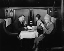 Picking up the tab in train dining car - stock photo