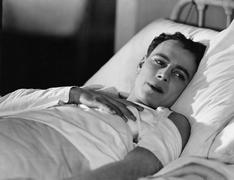 Portrait of injured man in bed Stock Photos