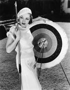 Female archer with bulls eyes - stock photo
