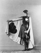 Female sword fighter wearing cape with hearts Stock Photos
