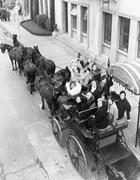 Group of women in horse drawn carriage - stock photo