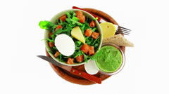 Green salad in green bowl Stock Footage