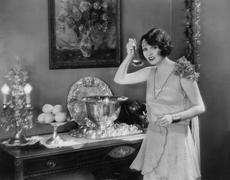 Portrait of woman with ladle and punch bowl Stock Photos