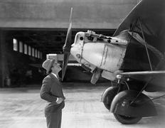 Man admiring plane Stock Photos