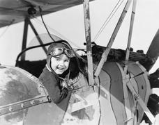 Little boy in cockpit of plane Stock Photos