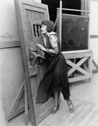 Woman with heavy door - stock photo