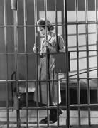 Woman in jail cell - stock photo