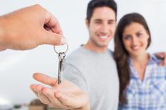 Man being given a house key - stock photo