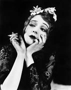 Portrait of woman smoking - stock photo