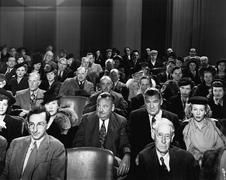 Attentive audience in theater - stock photo