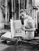 Portrait of woman reading Catholic text - stock photo