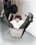 Woman falling into basket Stock Photos
