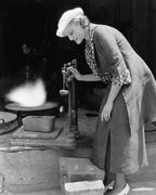 Woman weighing silver outside foundry Stock Photos